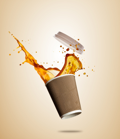 Take away cup with splashing coffee or tea liquid separated on brown background. Hot drink with splash, beverages and refreshment.