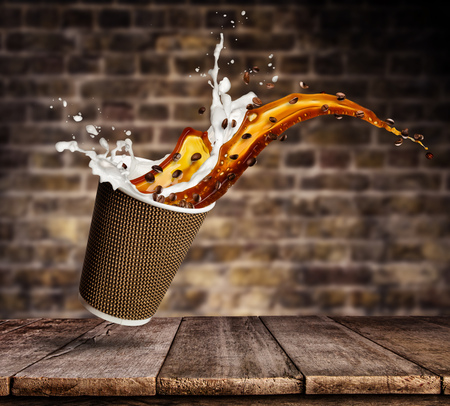 Take away cup with splashing coffee and milk liquid on wooden planks. Hot drink with splash, beverages and refreshment. Stok Fotoğraf