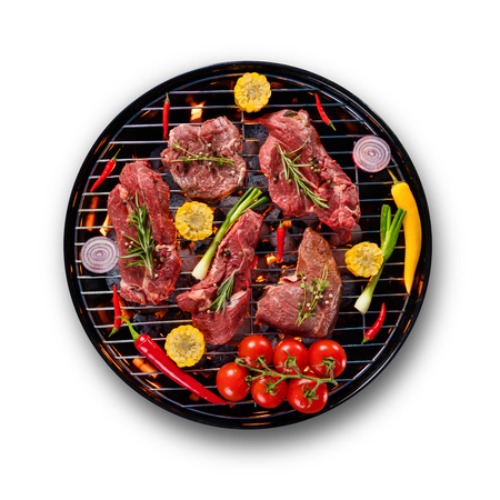 Fresh raw beef steaks with vegetable placed on grill, isolated on white background. Cooking, preparation and barbecue objects.