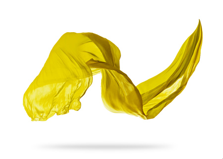 Smooth elegant yellow transparent cloth separated on white background. Texture of flying fabric. Reklamní fotografie