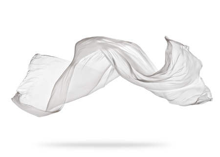 白い背景の上に滑らかなエレガントな白い透明な布が区切られます。飛んでファブリックのテクスチャです。 写真素材