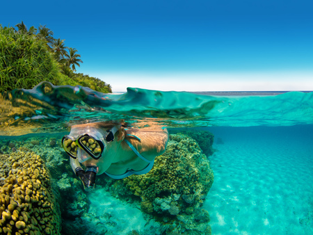Snorkeling woman exploring beautiful ocean sealife, under and above water photography. Travel lifestyle, water sport outdoor activities, swimming and snorkeling on summer beach holidays. Stock fotó