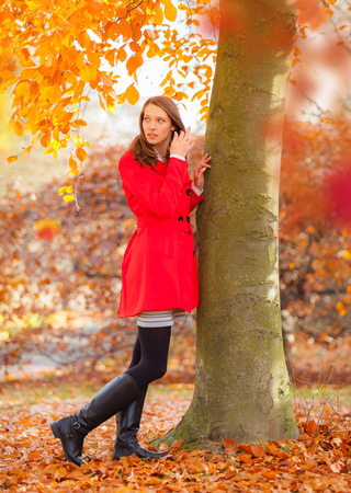 Beautiful young woman with red jacket. Beauty and fashion photo, seasonal and holiday autumn.