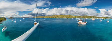 Panoramic view on beautiful Adriatic bay with yachts, shot from main spar of sailing boat. Reklamní fotografie