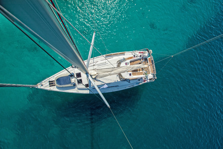 View from high angle of sailing boat. Aerial photography of ship deck, shot from main spar.
