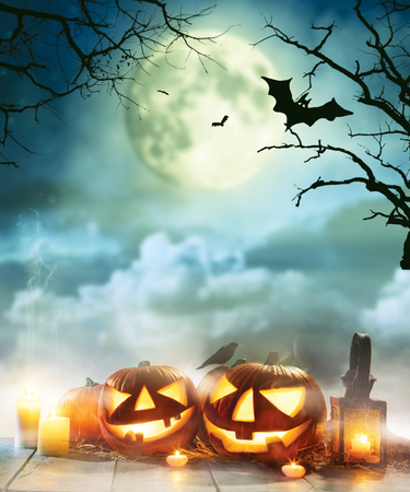 Spooky halloween pumpkins on wooden planks with dark horror background. Celebration theme, copyspace for text. Very high resolution image Stock Photo