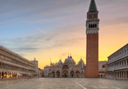 Beautiful sunrise on famous st.Marco square with clock tower in Venice, Italy, Europe. Historical heritage.