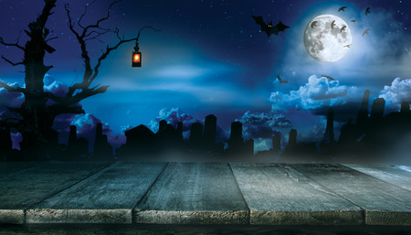 Spooky halloween background with empty wooden planks, dark horror background. Celebration theme, copyspace for text. Ideal for product placement Stock Photo