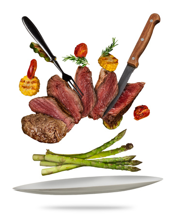Flying beef steaks with grilled vegetable served on plate. Concept of flying food. Separated on white background. High resolution size Stok Fotoğraf - 90109194