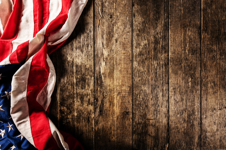 Close-up of USA flag in grunge design, placed on old wooden planks. Motive of celebration, free space for text