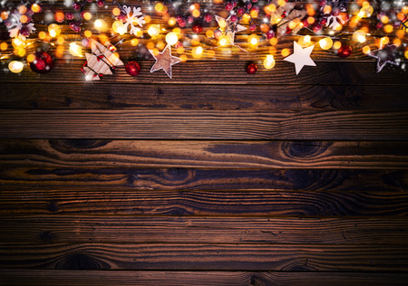 Christmas background with wooden decorations and spot lights. Free space for text. Celebration and decorative design. Stock Photo