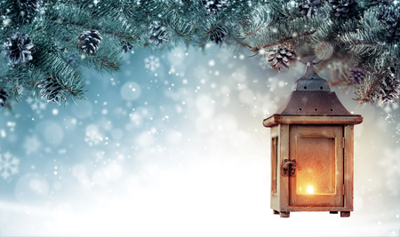 Christmas background with spruce branches and wooden lantern. Abstract holiday concept with empty vintage planks. High resolution image
