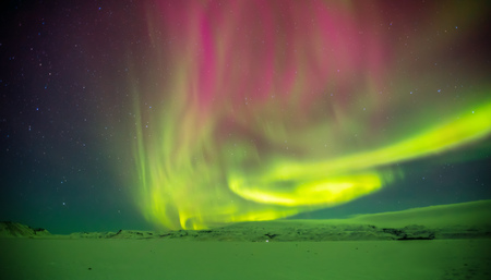 Beautiful aurora borealis light in Iceland, shot in early winter period