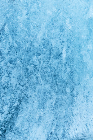 Texture of glacier ice in close-up detail. Realistic ice pattern structure Imagens