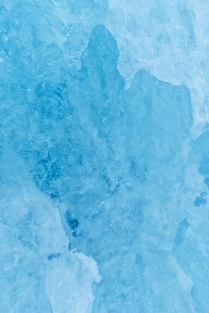 Texture of glacier ice in close-up detail. Realistic ice pattern structure Stock Photo