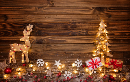 christmas background with wooden decorationsmoose tree and spot lights free space for