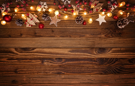 Christmas background with wooden decorations and spot lights. Free space for text. Celebration and decorative design. Imagens