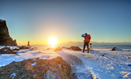 Young man traveler, Iceland. The concept of freedom and travel. Winter landscape, outdoor activity and sport Stock Photo