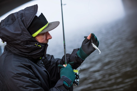 Sport fisherman showing plastic bait fish. Leisure and hobbies activities in outdoor, urban fishing Reklamní fotografie