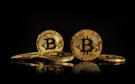 Pile of bitcoins, cryptocurrecny of future. Concept of e-commerce, e-business and finance. Isolated on blacke background Stock Photo