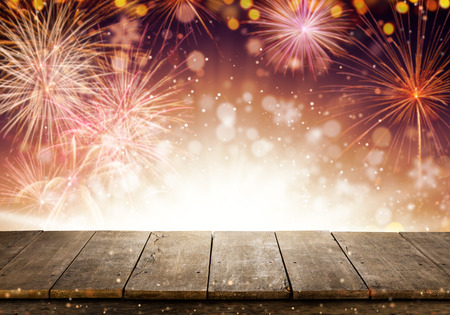 Abstract colored firework background with empty wooden planks, free space for product placement. Celebration, success, new year and anniversary concept