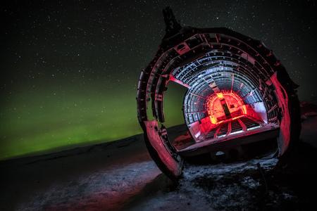 Beautiful illuminated airplane wreck on Solheimasandur, Iceland. Famous tourist place of abandoned wreck of American navy, Dakota.