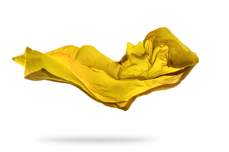 Smooth elegant golden transparent cloth separated on white background. Texture of flying fabric. Very high resolution image