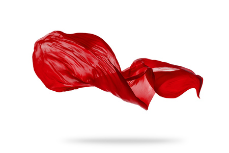 Smooth elegant red transparent cloth separated on white background. Texture of flying fabric. Very high resolution image