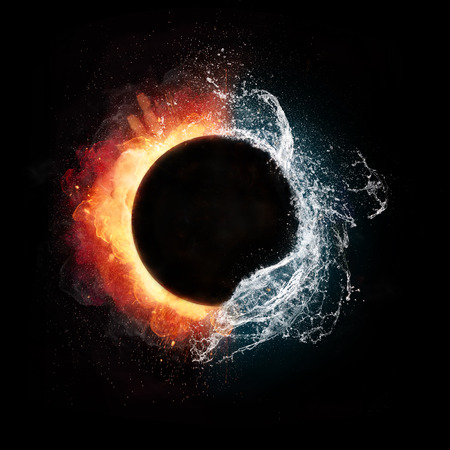 Fire and water elements in spherical shape, isolated on black background Standard-Bild