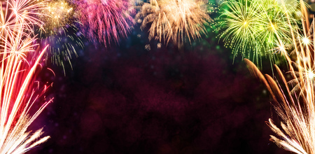 Celebration background with fireworks explosions. Anniversary and holidays concept Stock Photo