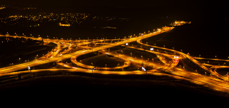 Aerial view of highway crossroad at night. Traffic and transportation. Shot on long exposure Reklamní fotografie