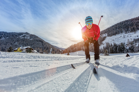 Cross-country skiing. Young man doing outdoor exercise. Winter sport and healthy lifestyle.