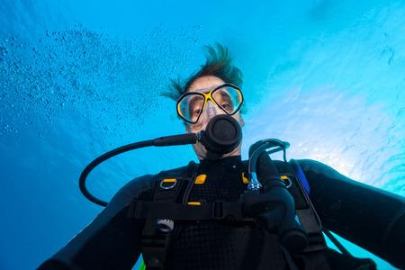 Young man scuba diver selfie, underwater activities