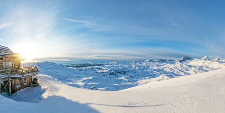 Winter panoramic view in Alps with log cabin. Outdoor activities on snow