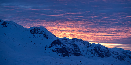 Beautiful sunset over Alpine mountains. Outdoor winter scenery
