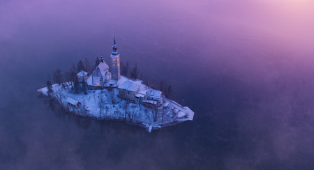 Aerial view of Bled lake in sunrise light, beautiful island with old church. Slovenia