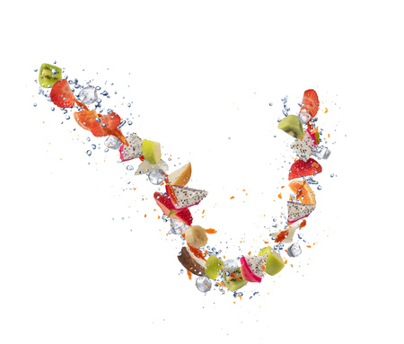 Pieces of flying fruit, isolated on white background. Fresh food and drink concept, healthy eating