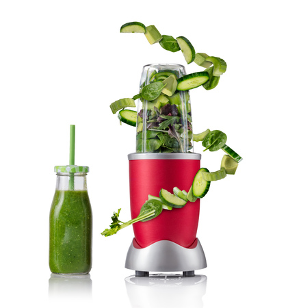 Smoothie maker mixer with vegetable flying ingredients, isolated on white background. Healthy drink and lifestyle Stok Fotoğraf