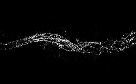 Water splash abstract shape isolated on black background.