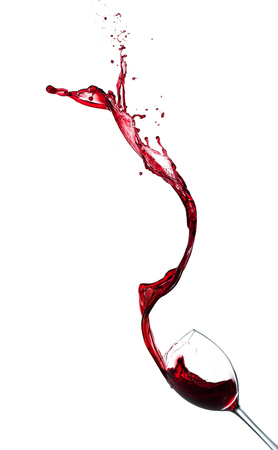 Red wine splashing from glass, isolated on white background. Stok Fotoğraf