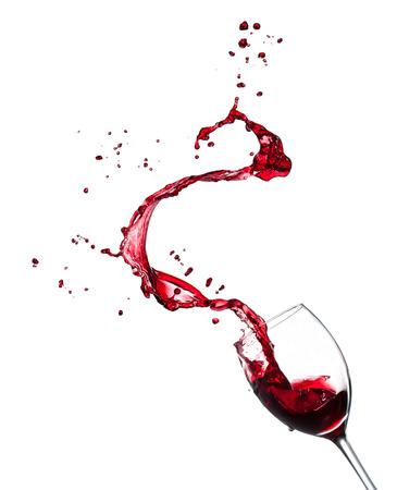 Red wine splashing from glass, isolated on white background. Stockfoto