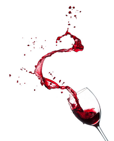 Red wine splashing from glass, isolated on white background. Archivio Fotografico