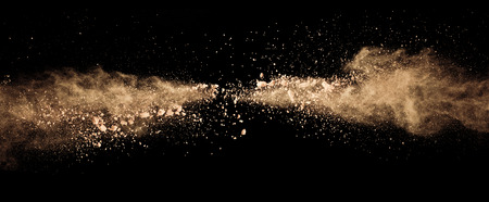 Abstract colored brown powder explosion isolated on black background. High resolution texture Stock fotó - 100025145