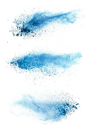Abstract blue powder explosion isolated on white background. High resolution texture 写真素材