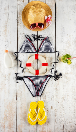 Beach accessories placed like figure of woman, top view. Summer holidays concept, free space for text. Very high resolution image