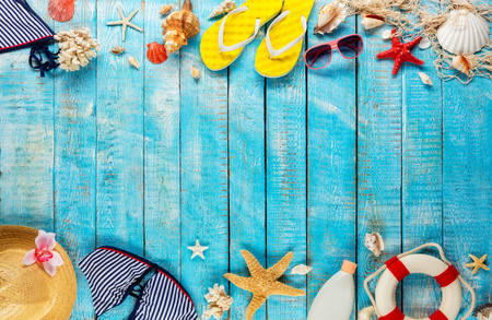 Beach accessories placed on blue wooden planks, top view. Summer holidays concept, free space for text. Very high resolution image Archivio Fotografico - 100136485