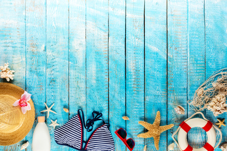 Beach accessories placed on blue wooden planks, top view. Summer holidays concept, free space for text. Very high resolution image Archivio Fotografico - 100136486