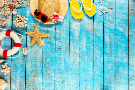 Beach accessories placed on blue wooden planks, top view. Summer holidays concept, free space for text. Very high resolution image