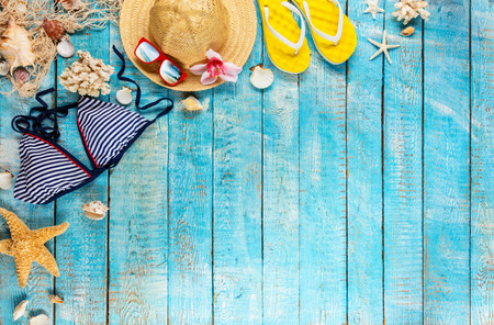 Beach accessories placed on blue wooden planks, top view. Summer holidays concept, free space for text. Very high resolution image Archivio Fotografico - 100136489