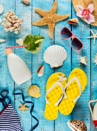 Beach accessories placed on blue wooden planks, top view. Summer holidays concept. Very high resolution image Archivio Fotografico - 100508300